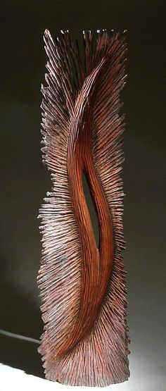 "Fleur 1 - Is a 42"" x 12"" x 4"" piece of Pink Locust wood with a patina, by Christophe Nancey"
