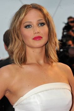 Cannes Film Festival 2013 Tousled hair in a centre-parted style perfectly offset Jennifer Lawrence's kohl-rimmed eyes and bold lipstick, for the Jimmy P. (Psychotherapy of a Plains Indian) premiere.