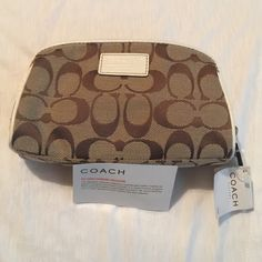 Coach cosmetic bag NWT. A coach cosmetic bag that is NWT.  Has three pockets inside the cosmetic bag. Never used, and still contains coach tissue paper inside. Coach Bags Cosmetic Bags & Cases