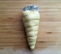 donut ice cream cone dough wrapped around foil cone