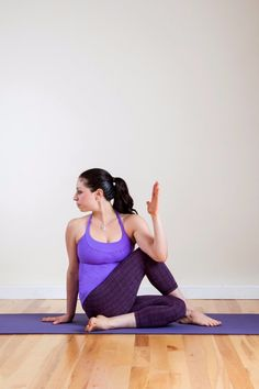 Yoga can help ease your back pain. Here's a yoga pose to help the aches go away, called the Seated Spinal Twist.
