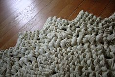Old sheets become a rug.