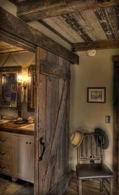Once again, you can never go wrong with a barn door!  Also love the ceiling and flooring