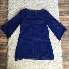 Blue lace top Royal blue lace top. 3/4 sleeve. Lining on the inside. Perfect condition! NO TRADES NO PAYPAL Boutique Tops