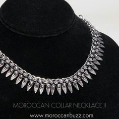 """A simple neckline becomes extraordinary with an elegant Moroccan Collar. This striking necklace was handmade in Tiznit, the """"jewelry capitol"""" of Morocco, using traditional Berber elements in an updated style. Approximately 16 inches long x .75 inches wide. Our handmade jewelry may vary slightly from the photo."""