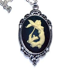 Mermaid Cameo Necklace - 40x30mm Cameo - Tattoo Style Pinup Mermaid. $15.00, via Etsy.