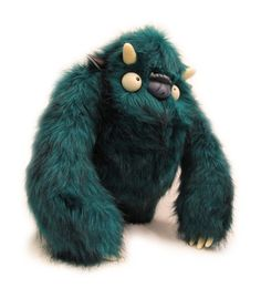 Designer: Paul Vincett. IT LOOKS LIKE A REJECT VERSION OF SULLY FROM MONSTERS INC