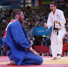 Antoine Valois-Fortier of Canada, right, reacts to defeating Travis Stevens of the U.S. in Judo on July 31.