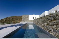 Perched on the Greek island of Paros overlooking the Aegean Sea, the As House brings classic Cycladic architecture to the century. The dwelling is. Paros Island, Construction, Pool Houses, Greek Islands, Architecture, Colorful Interiors, Greece, Exterior, House Design