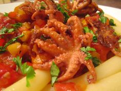 Baby Octopus In Spicy Salice Salentino/Bell Pepper Sauce With Ziti Lunga . See all pic's and recipe at : www.ChefsOpinion.org