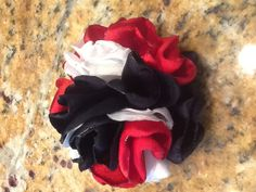 Red, White, and Navy Blue Flower