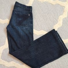 7 For All Mankind Dojo Jeans These jeans are great! They have just the right flare! I loved wearing them with a slimming shirt. No discoloration, just a little wear on bottom! But no tear! I never dried them! 7 for all Mankind Jeans Flare & Wide Leg