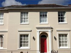 Walls in Farrow and Ball Joa's White and Farrow and Ball Rectory Red front door.