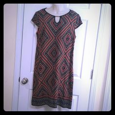 """Dress Forgot I had in the closet and now it doesn't fit me anymore. Price still attached. 40"""" long Armpit to armpit measured flat 20"""" Would fit a size 10-12 Dress Barn Dresses"""