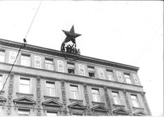 A group of people topple a Red Star from the top of a building during the 1956 Hungarian Revolution : HistoryPorn Hungary History, Interesting History, Historical Photos, More Photos, Budapest, Tao, Revolution, The Past, Louvre