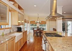 Traditional Kitchen with 3 in. Granite Countertop in New Venetian Gold, Limestone Tile, Columns, Galley, Stone Tile, Flush