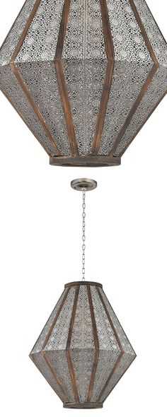 Don't you just love decorative pieces that make you look twice? Such is the case with the intricacy and intrigue of the Jeranda Pendant Lamp. Made with pierced metal and wood banding, the pendant deliv...  Find the Jeranda Pendant Lamp, as seen in the #TheGenieDen Collection at http://dotandbo.com/collections/thegenieden?utm_source=pinterest&utm_medium=organic&db_sku=115101
