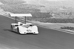 Phil Hill at speed in the 2E at Laguna Seca, 1966. Hill would win heat one and finish 2nd in heat two to claim the overall win. Hall was 2nd overall. This is chassis 2E-002, later rebuilt into the Chaparral 2G for the 1967 season and upgraded again for 1968 Can-Am season. Dave Friedman photo.
