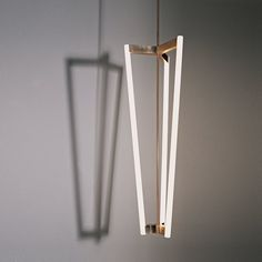 With its four rods, the Tube Chandelier casts a striking shadow when lit. Available in either satin brass or black plated stainless steel. Lighting Designer We Love: Michael Anastassiades by Eujin Rhee. Browse inspirational photos of modern homes. Cool Lighting, Modern Lighting, Lighting Design, Pendant Lighting, Modern Chandelier, Brass Chandelier, String Lights, Ceiling Lights, Rustic Homes