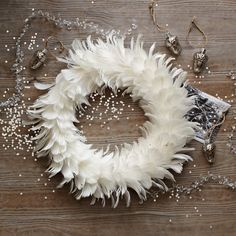 /\ /\ . Feather Wreath