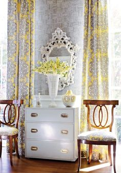 Gorgeous living room with Thibaut Loom Metallic on White Wallpaper, white rococo mirror, white campaign chest and chairs & yellow and gray window panels curtains in Thibaut Jakarta Yellow & Grey Fabric. Campaign Dresser, Campaign Furniture, Campaign Desk, French Living Rooms, Living Room Grey, Yellow And Grey Curtains, Gray Curtains, Printed Curtains, Yellow Fabric