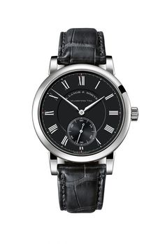 """The new version of A. Lange & Sohne's Richard Lange """"Pour le Merite"""" timepiece, with white-gold case and black dial, is limited to just 218 pieces, priced at $82,500.  The vital parts of the fusée-and-chain device are visible through the sapphire caseback and its movement is Lange's manufacture Caliber L044.  More @ http://www.watchtime.com/wristwatch-industry-news/watches/a-lange-sohne-richard-lange-pour-le-merite-now-in-white-gold/ #alangesohne #watchtime #horology #watchnerd"""