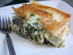 Oh My, Chicken Pie! from Food.com: A yummy filling of chicken, mushrooms, spinach, bacon and cheeses, layered between buttery-crisp sheets of phyllo. This recipe will make one 15 x 9 inch pan, which will serve 10-12 happy people, or two 8 x 8 inch pans, so you can bake one, and freeze the other (unbaked) to enjoy at a later date when time is short and good food is a must! All your meat and veg in one tasty packet. Developed for RSC #6.