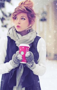 Cute winter outfit. Messy updo. Cat eyeliner makeup, colored lipstick and Starbucks coffee. Perfect.