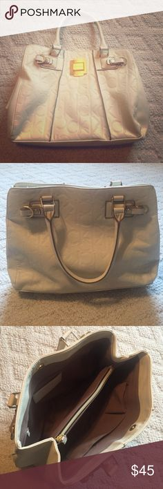 Calvin Klein purse Cream colored bag. Calvin Klein's signature CK all over bag. Used once. Few scratches on from gold piece from storage. Calvin Klein Bags Totes