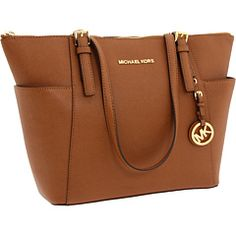 My new purse! Early birthday present to myself! It's amazing! Perfect for any outfit and any season!