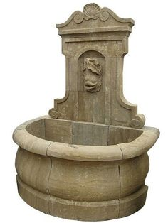 Wall Fountain. 'Dolphin Mask'. Material: Hand Carved Stone with an Etched Antique Finish