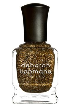 Obsessed with this bold gold Deborah Lippmann glitter nail polish.