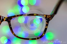 Eyeglasses against bokeh Christmas lights background. Vision or business concept