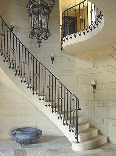 Wrought Iron railing at stone staircase, and cut stone finish walls