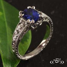 PLATINUM FLORAL CARVED MOUNTING $5608 including centre stone Ovel 1.72ct Blue sapphire set in center