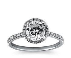 I really want to add a halo and side stones to my engagement ring (now a solitaire).  Paul thinks I shouldn't change it...