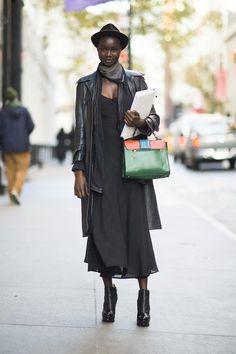Toughen up a floaty dress with a leather coat and platform booties. Source: Adam Katz Sinding