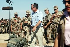 Operation Desert Storm   U.S. President George H.W. Bush preparing to speak to troops at a Thanksgiving gathering, during the Persian Gulf War. (1990-1991)