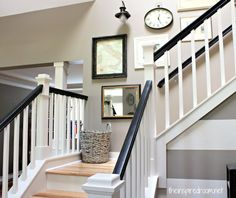 staircase makeover black and white railings hickory treads white risers - love the rustic yet modern combo!