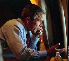 Powerful picture of President Bush aboard Airforce one on 9/11 talking to VP Cheney giving him orders to have any planes remaing in the air to be shot down..if necessary..