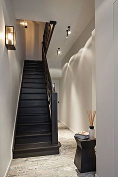 It may be small and narrow, but that doesn't mean your stairway can't get the same decorating treatment as the rest of your house. These staircase decorating ideas will give your entryway a step up. Find and save ideas about Painted stairs. Basement Stairs, House Stairs, Carpet Stairs, Style At Home, Black Stairs, Black Painted Stairs, Painted Staircases, Flur Design, Entry Hallway