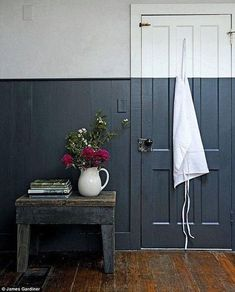 The striking dual-toned walls in the kitchen – half light grey plaster and half dark blue paint – are a fresh take on classic wall panelling; the crisp dividing line is a modern replacement for a dado rail, and with the contrasting lighter shade gives the Half Painted Walls, Half Walls, Painted Stairs, Dado Rail Hallway, Decoration Bedroom, Wall Decor, Two Tone Walls, Decoration Originale, Wall Colors
