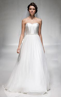 A wonderful flowing, simple wedding gown from Madeline Isaac James