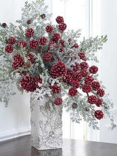 Red pine cone arrangement. Use white pine cones or silver for winter