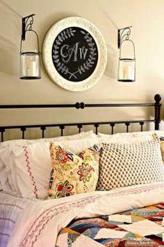 DIY Master Bedroom Ideas with monogram chalkboard, ikea duvet cover, spray painted headboard in master bedroom via www.goldenboysandme.com
