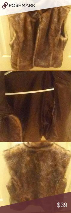 VEGAN FUR VEST NWOT VEGAN FRIENDLY VEST REVERSABLE TO  VEGAN LEATHER BEAUTIFUL  BRAND NEW  SOFT LOOKS LIKE REAL FUR PARTIAL TAG I THINK ON BRAND NEW Jackets & Coats Vests