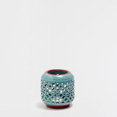 PERFORATED-SURFACE TEALIGHT HOLDER