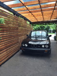 Horizontal Cedar Slate Carport: I decided to updated the old carport and make it a bit more modern. I used the existing post/beams and stained them with a semi-transparent black stain. Next I refreshed the roof structure with fresh lumber and a cedar stain topped with smoked polycarbonate. Then to give it some modern character I milled down some reclaimed cedar siding to 2.5 inch slates and Brad nailed it to the posts. Working at it in my free time the entire project took a couple weeks.