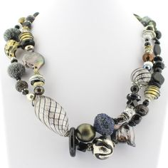 Neutral color multi-strand Murano Glass bead necklace with black, clear, gray and bronze beads - Materials: Hand-blown Venetian Murano glass beads - Clasp: Lobster Claw - Length: approximately 22 inch