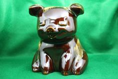 Vintage Hull Piggy Bank Brown Drip Glaze with Turquoise / Seafoam Green Accents by TheCopperDaisy on Etsy https://www.etsy.com/listing/192466401/vintage-hull-piggy-bank-brown-drip-glaze